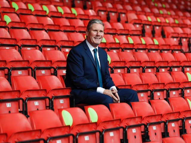 Labour Leader Keir Starmer sits in social distanced seating during a visit of Walsall Football Club on September 19, 2020 in Walsall, England.