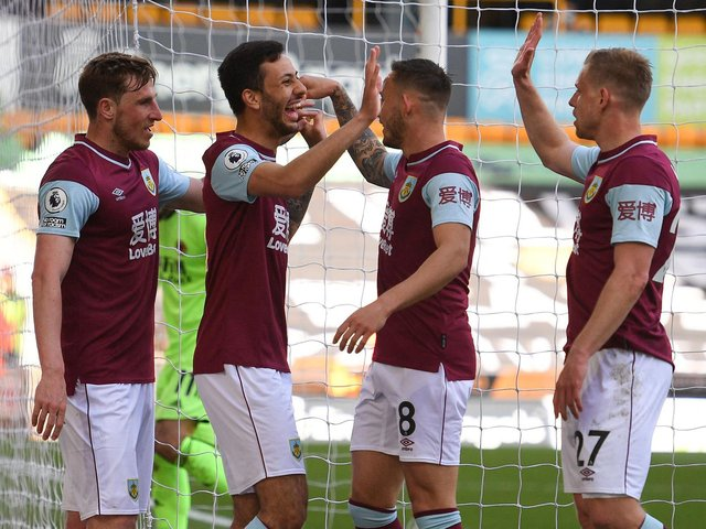 Burnley's New Zealand striker Chris Wood (L) celebrates with Dwight McNeil (2L), Josh Brownhill (2R) and Matej Vydra (R) during the English Premier League football match between Wolverhampton Wanderers and Burnley at the Molineux stadium in Wolverhampton.