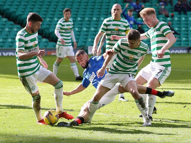 Rangers striker Kemar Roofe is crowded out by the Celtic defence during the Ladbrokes Scottish Premiership match between Celtic and Rangers at Celtic Park on March 21, 2021 in Glasgow, Scotland.