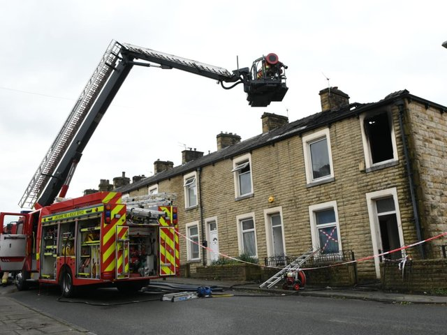 There is severe fire damage at the end terrace property
