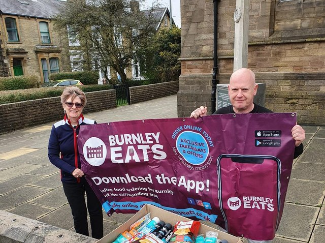 Burnley Eats sales director Karl Greenwood hands over the box of mens' toiletries to Pat Greenwood at St Matthew's Church.