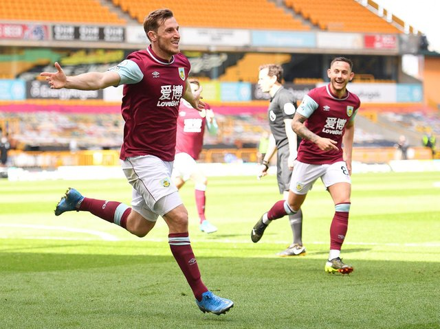 Chris Wood of Burnley celebrates after scoring their side's third goal and his hat trick during the Premier League match between Wolverhampton Wanderers and Burnley at Molineux on April 25, 2021 in Wolverhampton, England.