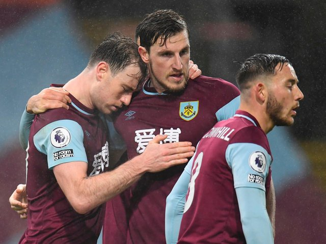 Burnley's English striker Ashley Barnes (L) celebrates with Burnley's New Zealand striker Chris Wood (C) after scoring first goal during the English Premier League football match between Burnley and Wolverhampton Wanderers at Turf Moor on December 21, 2020.