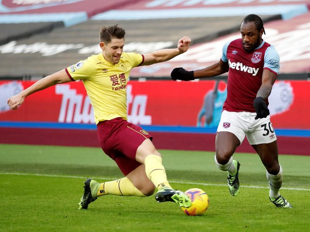 West Ham United's English midfielder Michail Antonio (R) vies with Burnley's English defender James Tarkowski during the English Premier League football match between West Ham United and Burnley at The London Stadium, in east London on January 16, 2021.