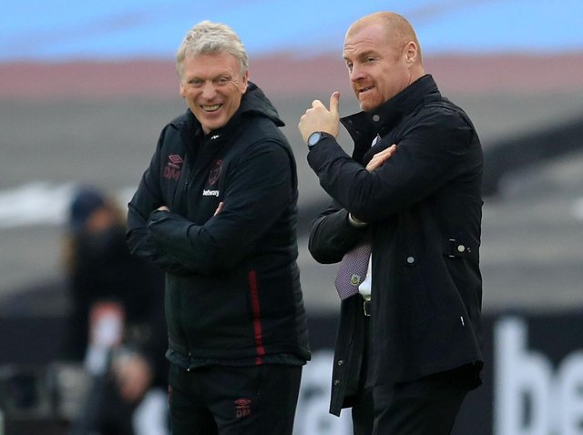 West Ham United's Scottish manager David Moyes (L) talks with Burnley's English manager Sean Dyche ahead of the English Premier League football match between West Ham United and Burnley at The London Stadium, in east London on January 16, 2021.
