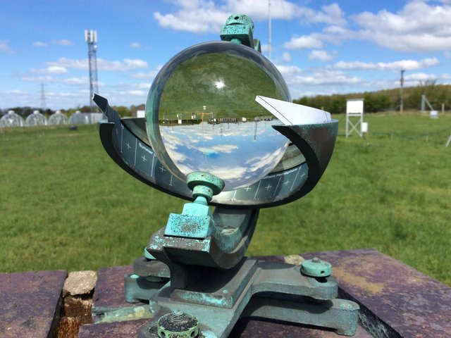 A Campbell Stokes sunshine recorder at Lancaster University's Hazelrigg weather station. It uses a magnifying glass which burns a card when it is sunny to leave a recording. Researchers from the university say April 2021 has been the sunniest on record