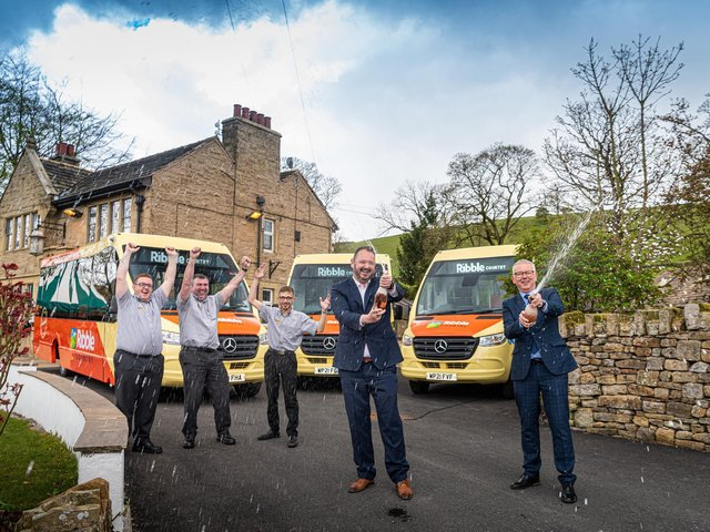 Celebrating the launch of the new bus network serving the Ribble Valley are, from left, drivers Chris Corey, Steve Beharrell and Curtis Payne; Transdev CEO Alex Hornby; and Lancashire County Council public transport manager Andrew Varley.