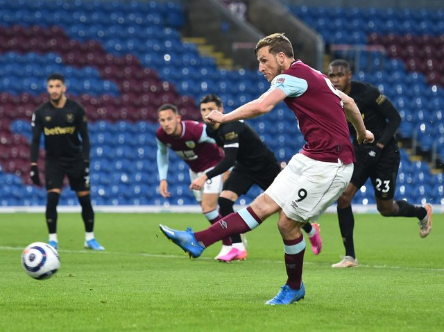 Chris Wood of Burnley scores their side's first goal from the penalty spot during the Premier League match between Burnley and West Ham United at Turf Moor on May 03, 2021 in Burnley, England.