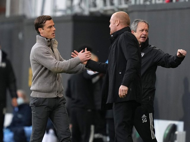 Scott Parker, Manager of Fulham interacts with Sean Dyche, Manager of Burnley prior to the Premier League match between Fulham and Burnley at Craven Cottage on May 10, 2021 in London, England.