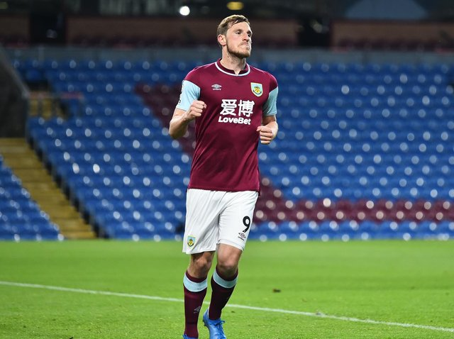 Chris Wood of Burnley celebrates after scoring their side's first goal during the Premier League match between Burnley and West Ham United at Turf Moor on May 03, 2021 in Burnley, England.