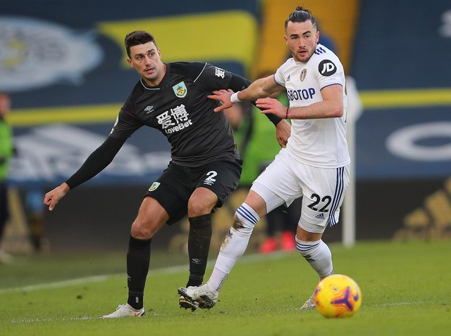 Jack Harrison of Leeds United battles for possession with Matthew Lowton of Burnley during the Premier League match between Leeds United and Burnley at Elland Road on December 27, 2020 in Leeds, England.
