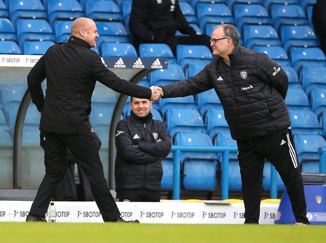 Sean Dyche, Manager of Burnley shakes hands with Marcelo Bielsa, Manager of Leeds United prior to the Premier League match between Leeds United and Burnley at Elland Road on December 27, 2020 in Leeds, England.