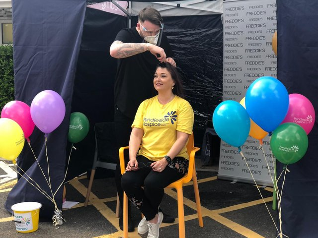 Lisa Pearson during the her head shave by Nick Wright at Pendleside Hospice