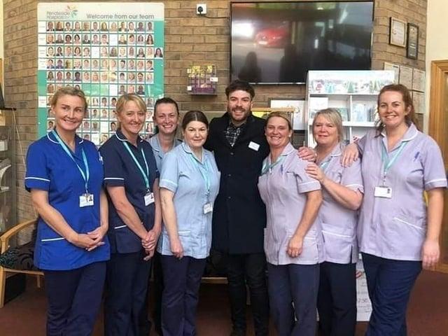 Pendleside Hospice nursing staff with their ambassador, TV and radio star Jordan North