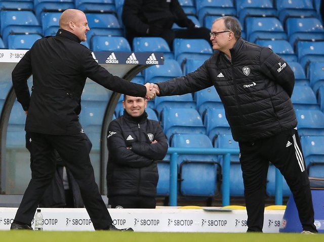 Burnley's English manager Sean Dyche (L) and Leeds United's Argentinian head coach Marcelo Bielsa (R) shake hands ahead of the English Premier League football match between Leeds United and Burnley at Elland Road in Leeds, northern England on December 27, 2020.