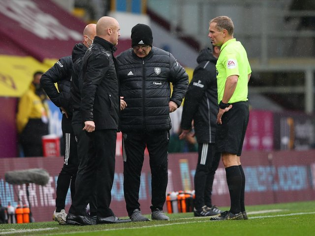 Referee Graham Scott speaks to Sean Dyche and Marcelo Bielsa