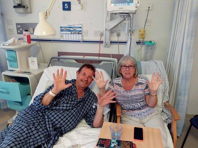 Dave, with his wife Harriet, writes a witty account of his stay in hospital in 2018
