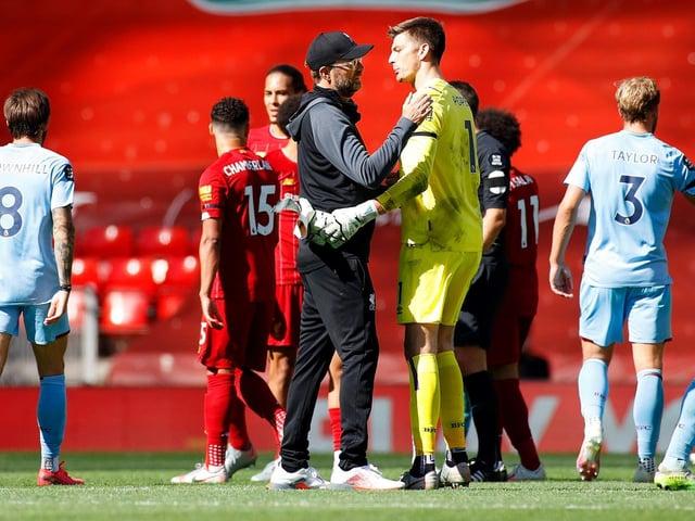 Jurgen Klopp with Nick Pope at Anfield last season
