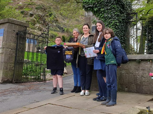 Competition winner Maggie standing next to her mum Liz. Being presented with her prizes by Clean Up Clitheroe founder Miss Jeanette Pateman with help from her son Jack.