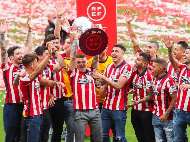 Kieran Trippier raises the La Liga trophy aloft