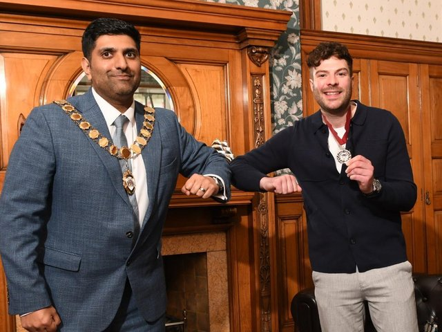 Jordan North receives his award from the Mayor of Burnley, Lord Khan. Picture: Burnley Borough Council