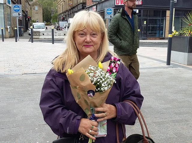 Flowers were handed out to shoppers in Burnley town centre as a 'thank you' for their support