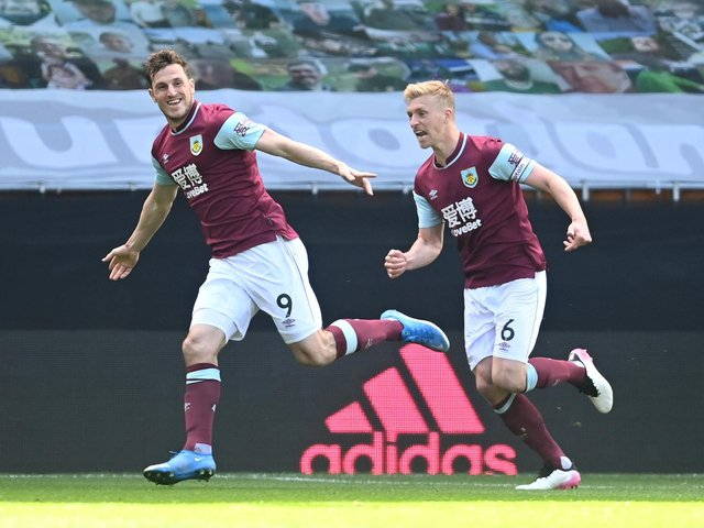 Chris Wood of Burnley celebrates with Ben Mee after scoring their side's third goal and his hat trick during the Premier League match between Wolverhampton Wanderers and Burnley at Molineux on April 25, 2021 in Wolverhampton, England.