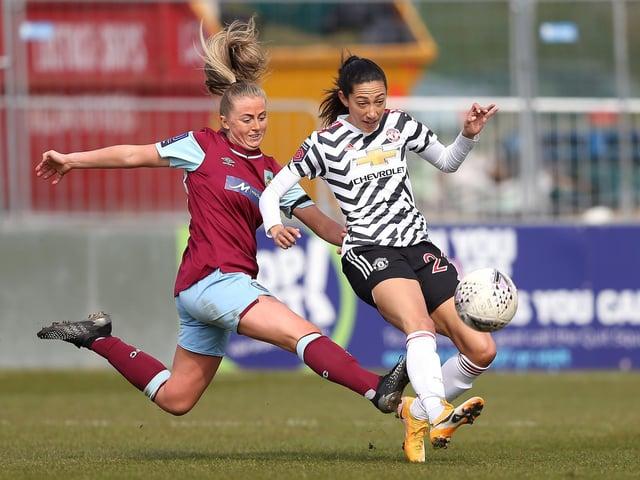 Christen Press in action against Manchester United Women