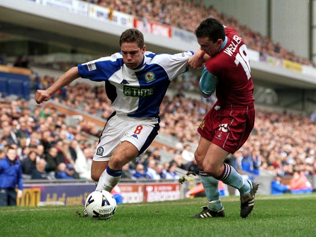 Paul Weller of Burnley tries to tackle David Dunn of Blackburn Rovers during the Nationwide League Division One game between Blackburn Rovers v Burnley at Ewood Park, Blackburn.