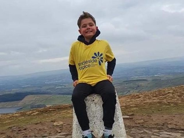 Nine-year-old Riley on one of his many trips to the Pendle Hill trig point