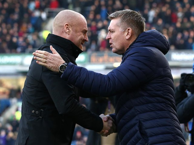 Dean Smith, Manager of Aston Villa shakes hands with Sean Dyche of Burnley prior to the Premier League match between Burnley FC and Aston Villa at Turf Moor on January 01, 2020 in Burnley, United Kingdom.