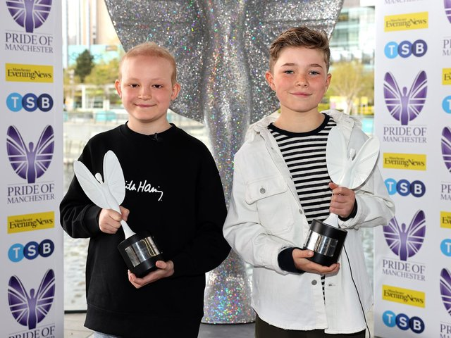 Inspirational best friends Hughie Higginson and Freddie Xavi with their Pride of Manchester trophies