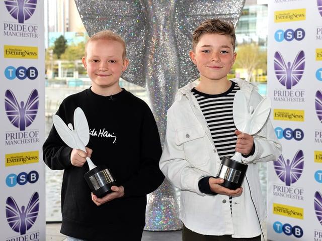 Fundraising best friends Hughie Higginson and Freddie Xavi with their award
