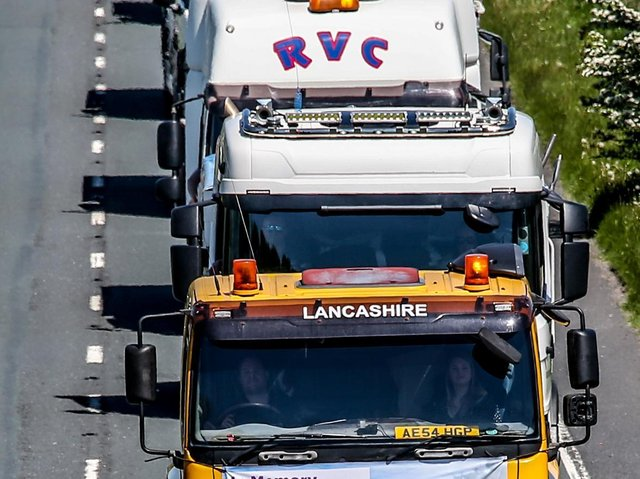 The procession of trucks. Picture by David Johnston