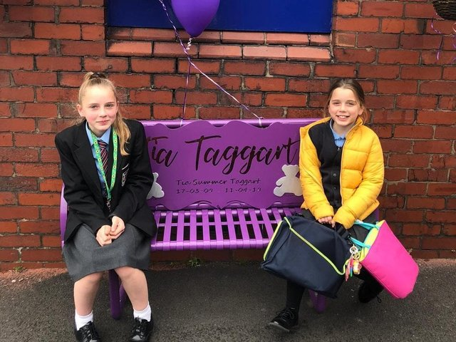 Tia's best friend Chloe Metcalfe (left) could not attend the bench unveiling ceremony as she was at school so her sister Sophie cut the ribbon on her behalf.