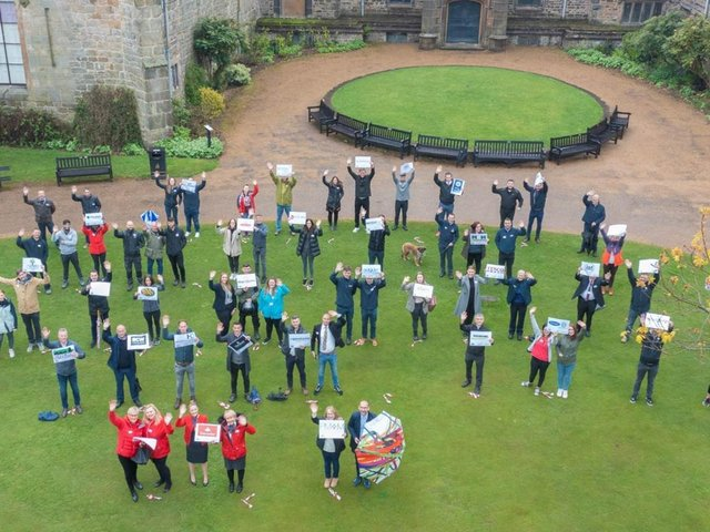 Representatives of 35 businesses taking part in the MEGA Raisathon are pictured by drone outside Towneley Hall
