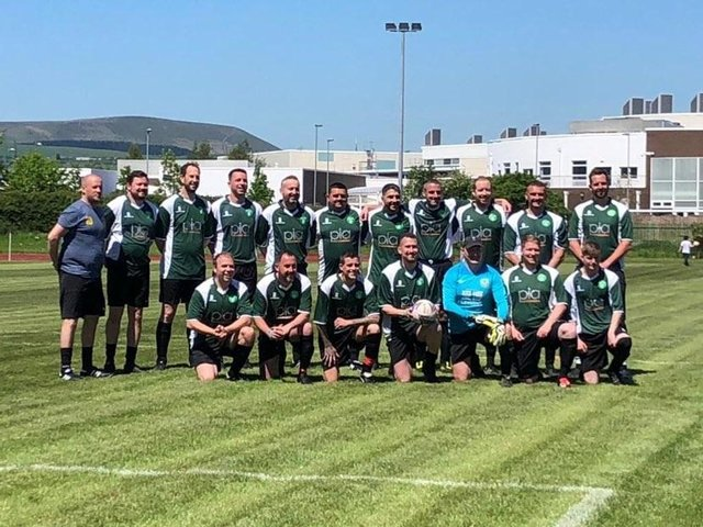 The 'Harry's Barmy Army' team take to the pitch with Mark (centre holding the football)