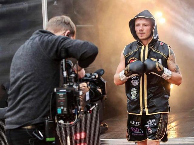 Josh Holmes makes his ring entrance at the Sheffield Arena [Photo: Karen Priestley]