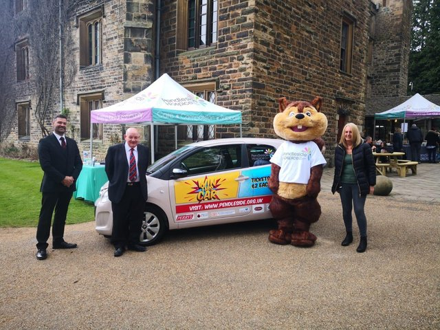(Left to right): Richard Edmondson, Alderson and Horan Funeral Services; Keith Jackson Whitford, Caravans and the Freemasons; Penny, Pendleside Hospice's mascot; Helen McVey, Pendleside Hospice Chief Executive.