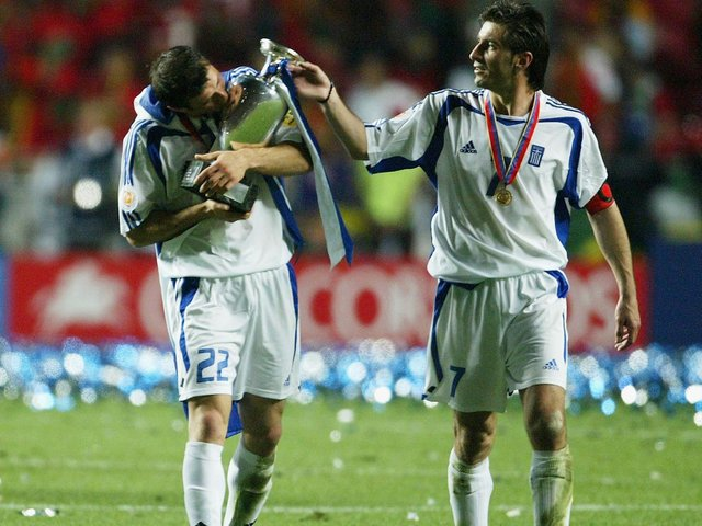 Former Clarets striker Dimi Papadopoulos kisses the European Championship trophy in 2004