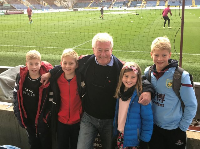 Stewart with his two youngest sons and his two grandchildren
