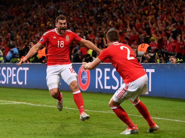 Sam Vokes (L) of Wales celebrates scoring his team's third goal with his team mates Chris Gunter (R) during the UEFA EURO 2016 quarter final match between Wales and Belgium at Stade Pierre-Mauroy on July 1, 2016 in Lille, France.