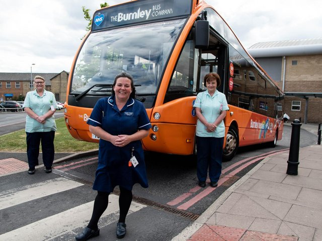 (Left to right) Health care assistant Christina Walls, midwife Rachel Magee-Thorpe and maternity support worker Diane Townsend at Burnley General Teaching Hospital with The Burnley Bus Company's 'Burnley Heroes' bus.