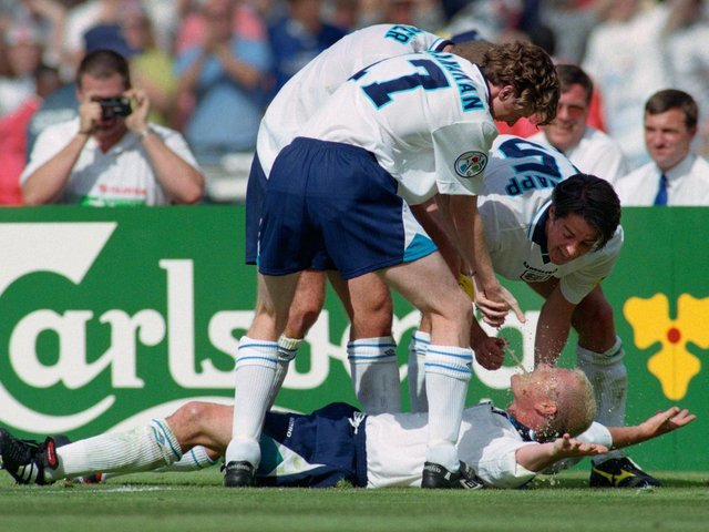 England goalscorer Paul Gascoigne celebrates in the 'Dentists Chair' with Steve McManaman, Alan Shearer and Jamie Redknapp during the 1996 European Championships group stage win over Scotland at Wembley