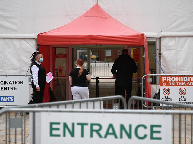 People enter from a Covid-19 vaccination centre set up at the Cathedral in Blackburn.