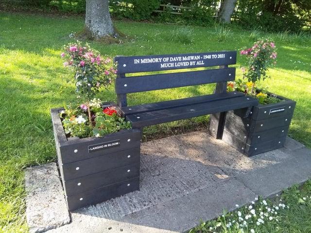The memorial bench and beautiful plantars in memory of Dave McEwan