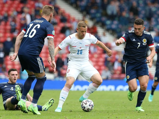 Matej Vydra of Czech Republic is closed down by Andrew Robertson, Liam Cooper and John McGinn of Scotland during the UEFA Euro 2020 Championship Group D match between Scotland v Czech Republic at Hampden Park on June 14, 2021 in Glasgow, Scotland.