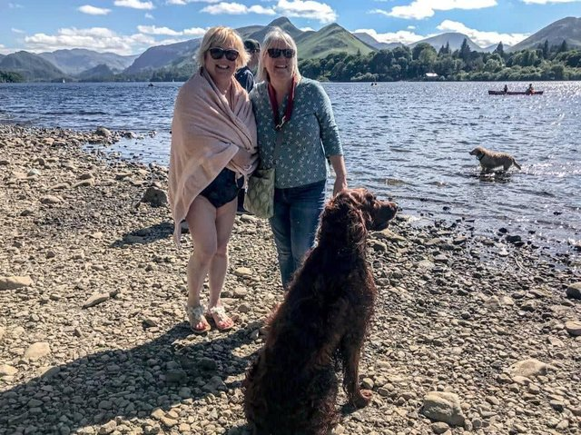 Sue Plunkett (left) after her open swimming experience in Derwentwater with her long time friend Marie and her dog Harley