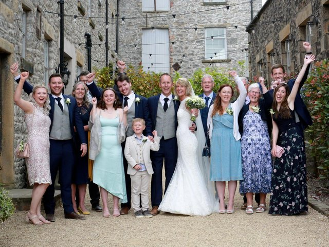 The happy couple with family. Photo credit: Zoie Carter Ingham Photography
