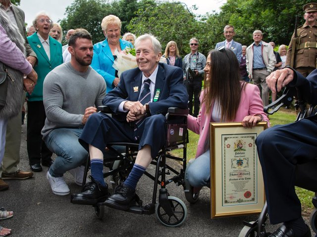 Bob Clark after receiving the Freedom of the Town, surrounded by well wishers including his granddaughter Sophie and wife Ann (photo by Naz Alam)